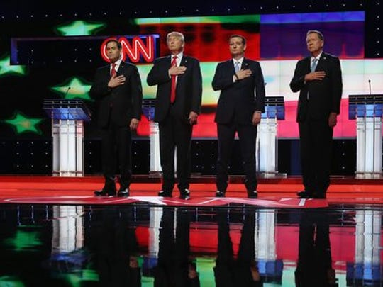 Marco Rubio, Donald Trump, Ted Cruz and John Kasich listen to the national anthem before the start of the Republican debate on March 10, 2016, in Coral Gables.
