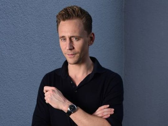 Tom Hiddleston looks into the camera in this picture,