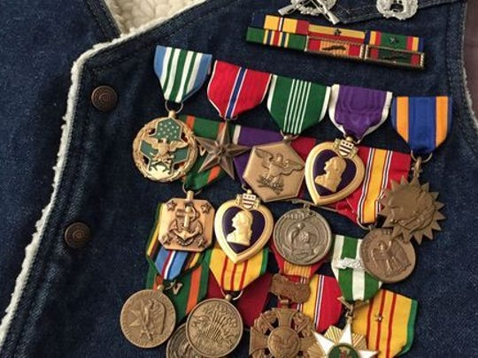 D.J. Bland's military medals still pinned to the denim