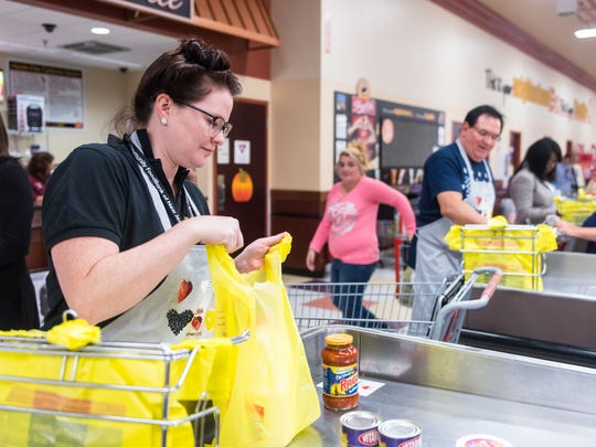 Briana Lyons, with the New Jersey Foodbank, bags groceries