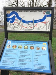 Signs along the running path on Arthur Ray Teague Parkway