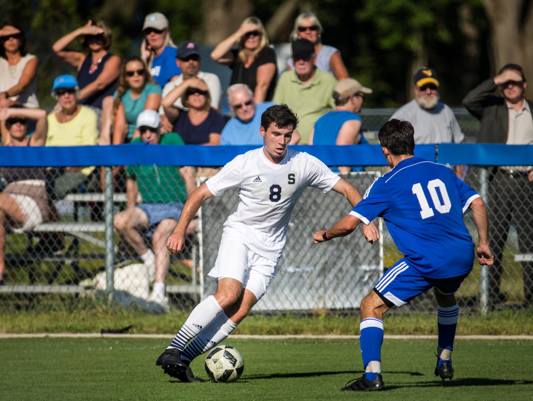 Salesianum's James Strine (No. 9) cuts past Wilmington Charter's Patrick O'Connor (No. 10) in the first half of Salesianum's 1-0 win over Wilmington Charter at the Hockessin Soccer Club in Hockessin on Thursday afternoon.