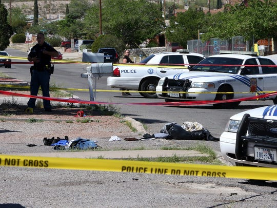 Clothing and other items lie on the ground in a driveway along Kemp Avenue near the intersection with Dyer Street after a fatal stabbing Wednesday in Northeast El Paso.