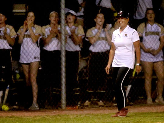 Riverdale softball coach Christi Bingham watches as