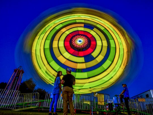 Rides spin as the Autauga County Fair is held in Prattville, Ala., on Thursday October 12, 2017. The fair runs through Saturday the 14th.