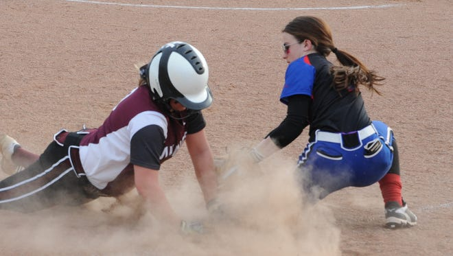 Zane Trace's Kaylea Cook tags out a runner at her third base position during a contest against Vinton County earlier this season.