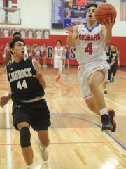 Cooper's Josh Henry (4) drives to the basket as Lubbock High's Nathaniel Gutierrez looks on. The Westerners beat Cooper 74-61 in the District 4-5A basketball game Tuesday, Jan. 30, 2018 at Cougar Gym.