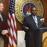Monroe Mayor Jamie Mayo (at podium) and Director of Administration David Barnes provide update of minimum wage increase plan Monday.