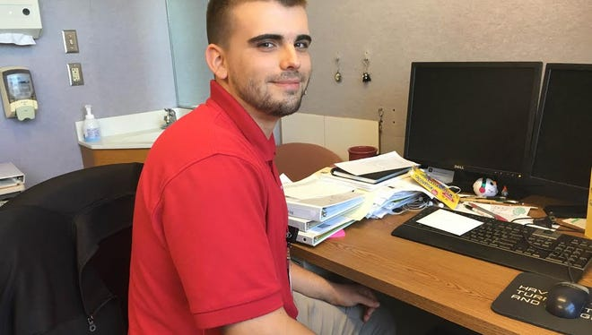 Jordan Moreno smiles while working at IU Health Ball Memorial Hospital on June 30. Moreno, who just graduated from Central High School, is working in the hospital's clinical informatics division this summer through TeenWorks.