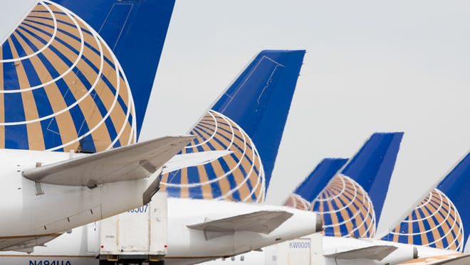 This file photo from May 7, 2017, shows United Airlines planes at Denver International Airport.