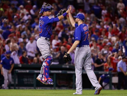 Chicago Cubs catcher Willson Contreras, left, celebrates with Wade Davis, right, after winning a baseball game against the St. Louis Cardinals, Friday, May 12, 2017, in St. Louis. (AP Photo/Tim Spyers)
