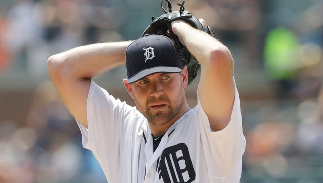 Detroit Tigers starting pitcher Mike Pelfrey prepares to throw during the first inning of a baseball game against the Houston Astros, Sunday, July 31, 2016, in Detroit.