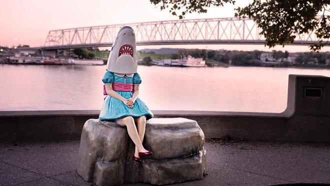 The Shark Girl sculpture stood along the Ohio River.