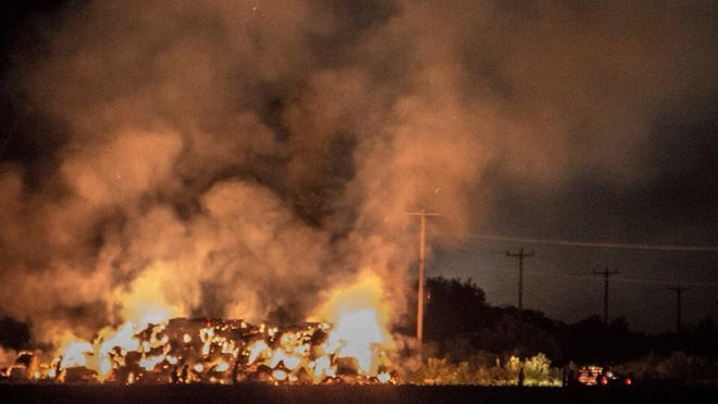 Firefighters battled a massive fire fueled by hay bales near Smyrna Wednesday night.