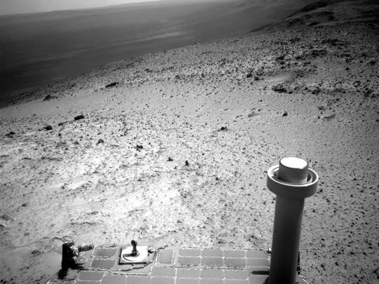 This image sent by NASA's Opportunity rover on Wednesday, Jan. 7, 2015 shows a view from atop a hill on Mars.