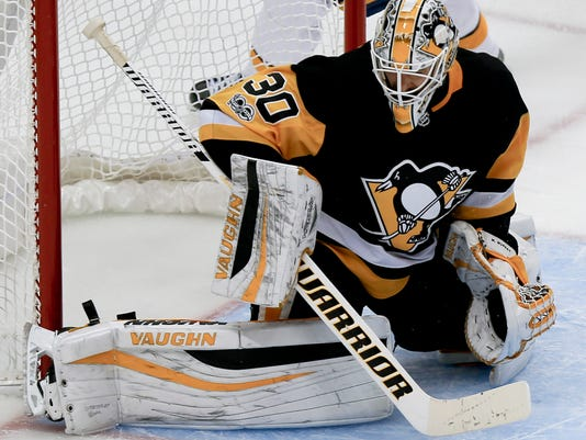 FILE - In this Oct. 7, 2017, file photo, Pittsburgh Penguins goalie Matt Murray (30) makes a save in the third period against the Nashville Predators during an NHL hockey game, in Pittsburgh. The Pittsburgh Penguins are relying on a youth movement in net in their pursuit of NHL history. The two-time defending Stanley Cup champions have the youngest goalie tandem in the league in 23-year-olds Matt Murray and Tristan Jarry, who are at the forefront of a wave of young netminders making a difference.(AP Photo/Keith Srakocic, File)