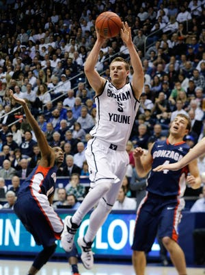 Brigham Young Cougars guard Kyle Collinsworth (5) moves towards the basket during the second half against the Gonzaga Bulldogs at Marriott Center.