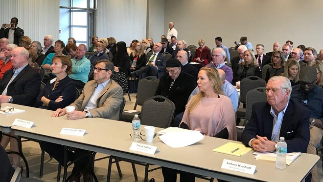 Indian River Medical Center leaders listen to consultants' analysis of proposals by four health systems competing to take over the county-owned hospital.