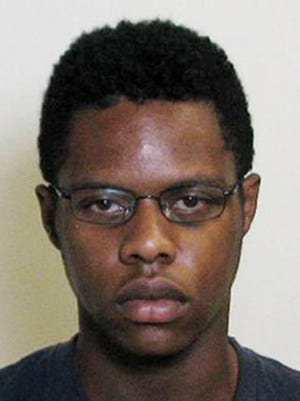 This undated photo provided by the Madison County Sheriff's Office shows Keaun L. Cook of Godfrey, Ill. Madison County State's Attorney Tom Gibbons said Thursday, Sept. 1, 2016, that Cook was charged with material support for terrorism and making a terrorist threat. Gibbons said the threats were verbal and that Cook had been in contact with a terrorist organization via multiple electronic means. (Madison County Sheriff's Office via AP)