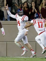 Bo Wallace (14) led Ole Miss to three bowl games.