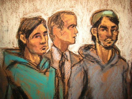 In this courtroom drawing, defendant Akhror Saidakmetov (left), an interpreter (center) and defendant Abdurasul Hasanovich Juraboev appear at federal court in New York on terrorism charges Wednesday. Saidakmetov and Juraboev are two of the three men arrested on charges of plotting to travel to Syria to join the Islamic State group and wage war against the United States.