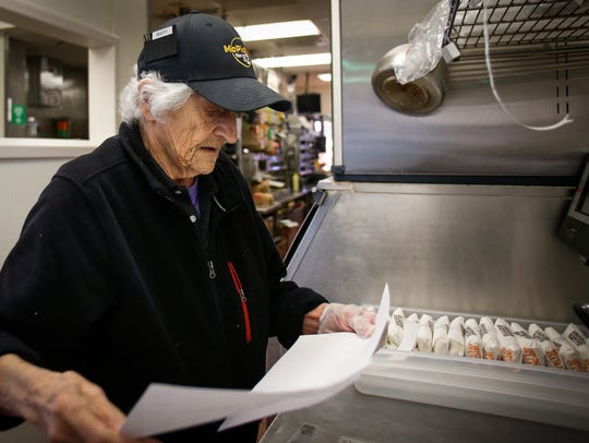 Mary Smith, 92, of Webberville checks her prep sheets