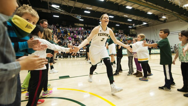 Vermont's Sydney Smith (3) is greeted by some kids during player introductions during a women's basketball game at Patrick Gym on Friday.