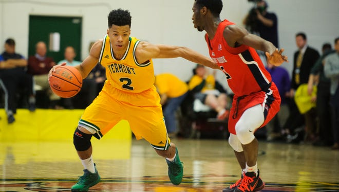 Vermont's Trae Bell-Haynes (2) drives to the hoop past Stony Brook's Elijah Olaniyi (3) during the America East men's basketball semifinal game between the Stony Brook Seawolves and the Vermont Catamounts at Patrick Gym on Tuesday night March 6, 2018 in Burlington.