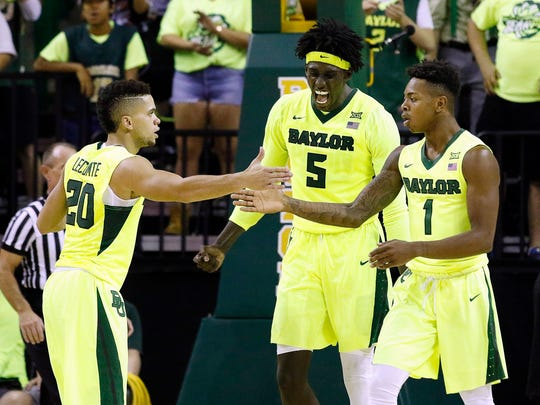 Baylor Bears guard Manu Lecomte (20) and forward Johnathan