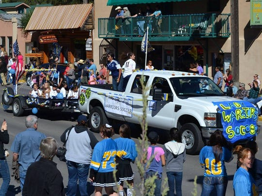 Parade goers line up at last year's Aspenfest Parade through midtown Ruidoso.
