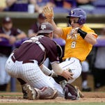LSU shortstop Alex Bregman (8) is tagged out at home by Texas A&M catcher Michael Barash, left, in the first inning on Saturday.