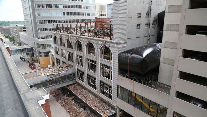 Dore & Associates demolition crews using industrial balloons to topple the north wall of the burned Younkers building in a file photo