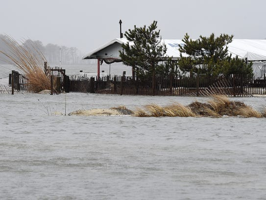 Flooding is occurring as tides rise in Dewey Beach
