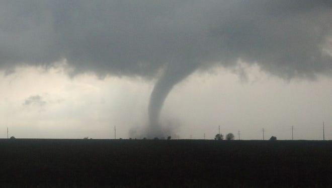 This file photo shows a tornado touching down near near Hampton in June 2013.