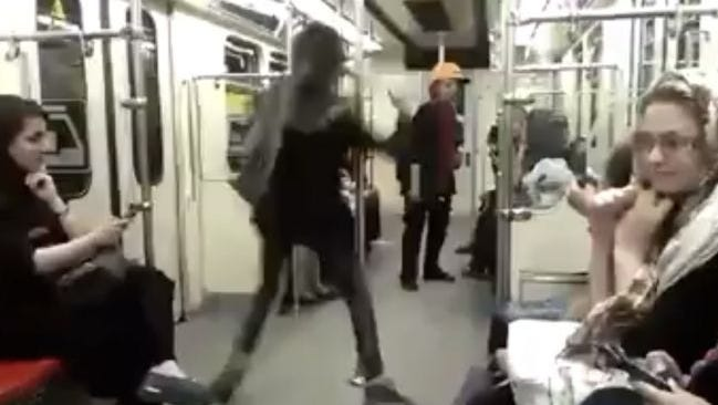 Still from a video of a woman dancing on Tehran's subway.