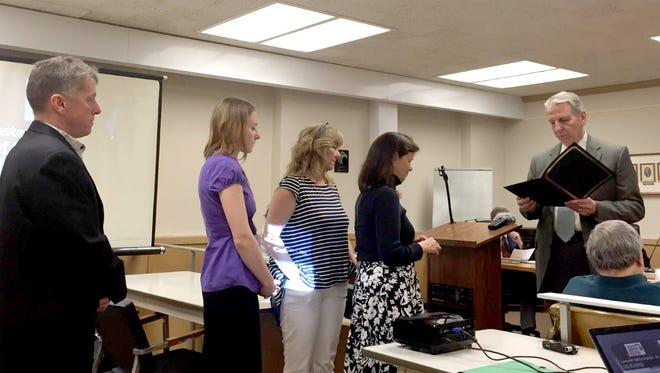 Lebanon City Council Chairman Wiley Parker reads a proclamation honoring former mayor Don Griffith (1980-84), who died on April 3, to Griffith's family, from left, son Kelly Griffith, granddaughter Saranika Griffith and daughters Melodie Brown and Teri Giurintano.