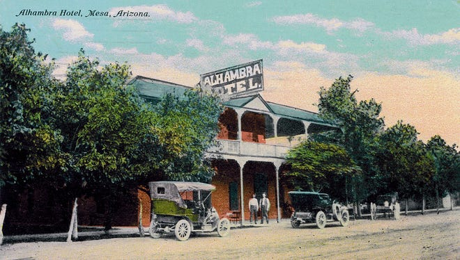 Nearly concealed by lush shade trees in an era before air-conditioning, the Alhambra Hotel in Mesa is pictured with its post-1898 front porch addition on an early 20th century postcard.