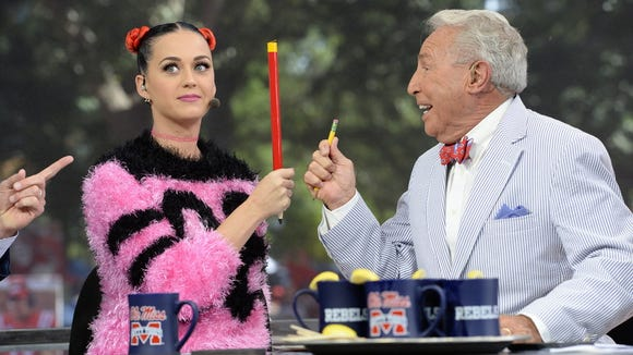 Katy Perry plays with ESPN analyst Lee Corso during her appearance on College GameDay in Oxford on Oct. 4.