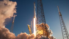 A SpaceX Falcon 9 rocket launches from Cape Canaveral