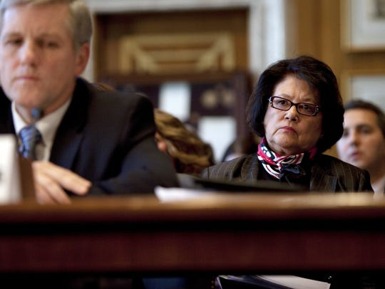 Elouise Cobell, right, looks on as Deputy Secretary
