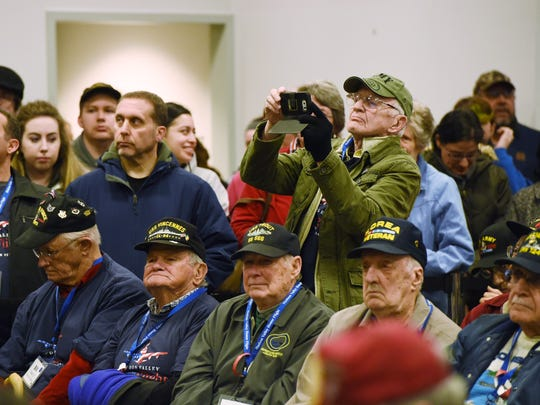 Veteran Thom Usher of Poughquag captures a moment on his phone during the beginning of the Hudson Valley Honor Flight at Stewart International Airport in New Windsor.