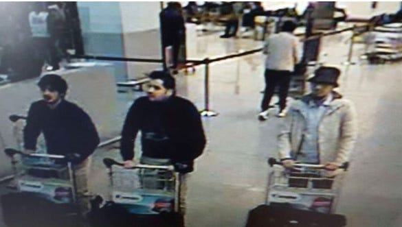 A picture released by the Belgian Federal Police shows a screengrab of the airport CCTV camera showing suspects of Tuesday's attacks at Brussels Airport, in Zaventem.