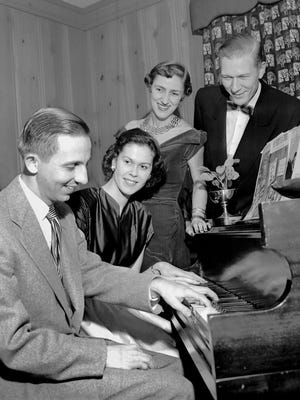 One of the festive events of December 1952 was a cocktail party given by Mr. and Mrs. William F. Bowld Jr. at their new home at 4062 North Walnut Grove Circle. Among the guests were two attractive newcomers to Memphis, Mr. and Mrs. Thomas A. Bellinghausen of Miami, Florida. At the piano are (from left), Mr. Bowld, Mrs. Bellinghausen, Mrs. Bowld and Mr. Bellinghausen.