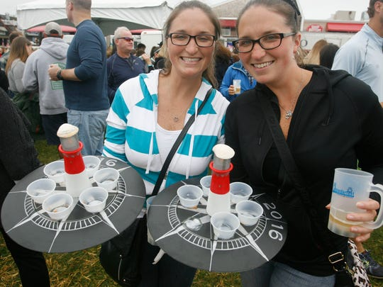 Emily Lyman, left, and Elizabeth White, twin sisters from Bayonne, N.J. brought their custom made chowder tables to the Chowder Fest Cook-Off Classic in Beach Haven, N.J. October 2, 2016.