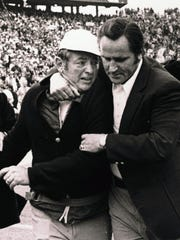 In this Jan. 13, 1974, file photo, Miami Dolphins assistant coach Bill Arnsparger, left, is hugged by coach Don Shula after Super Bowl VIII in Houston, in which the Dolphins defeated the Minnesota Vikings 24-7.