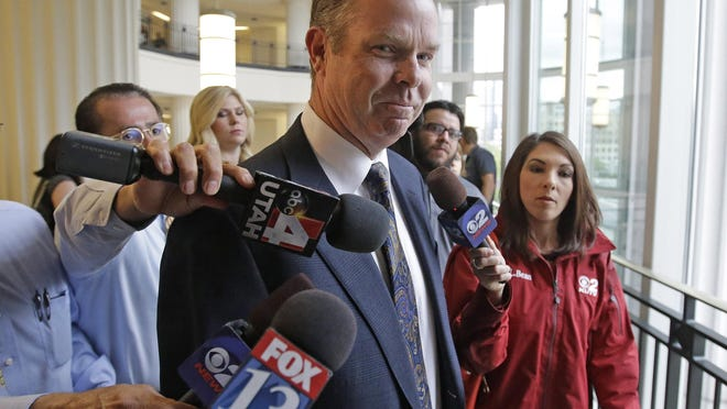 In this July 30, 2014, file photo, former Utah Attorney General John Swallow arrives at court, in Salt Lake City.