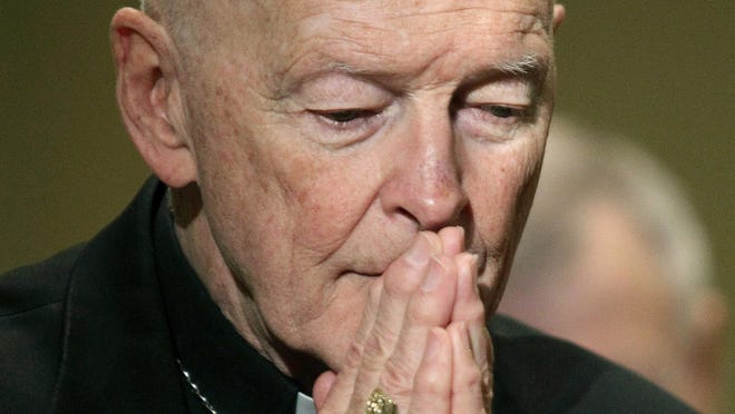 In this Nov. 14, 2011 file photo, Cardinal Theodore McCarrick prays during the United States Conference of Catholic Bishops' annual fall assembly in Baltimore.