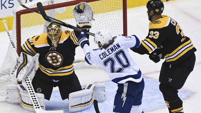 Boston Bruins goaltender Tuukka Rask (40) makes a glove save as Tampa Bay Lightning center Blake Coleman (20) and Bruins defenseman Zdeno Chara (33) look on during the second period of a NHL Stanley Cup playoff hockey game in Toronto, Ontario, Wednesday, Aug. 5, 2020.