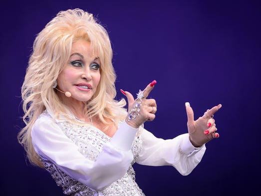 US country music singer Dolly Parton performs on the Pyramid Stage, on the final day of the Glastonbury Festival of Music and Performing Arts on Worthy Farm in Somerset, southwest England, on June 29, 2014.  AFP PHOTO / LEON NEAL        (Photo credit should read LEON NEAL/AFP/Getty Images)
