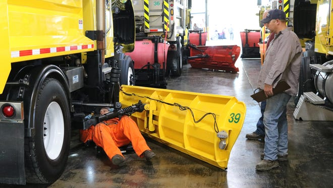 Road crews for the Ohio Turnpike's maintenance facility in Elmore inspect their equipment, especially the snow plows, to get ready for winter. Officials said they will be ready after hearing that snow flurries are possible next week,